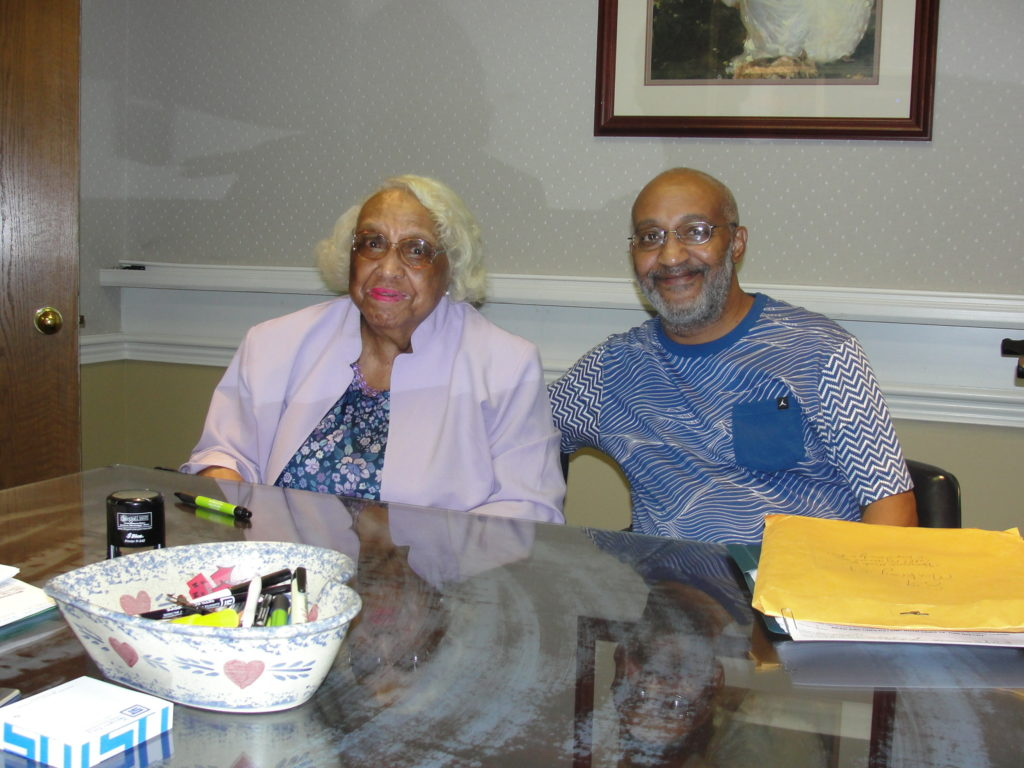 Ms. Constance Ashley and Lloyd Ashley at their house closing